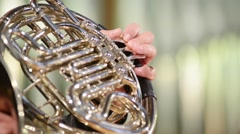 Horn plays the French horn, close up, blurred defocused background Stock Footage