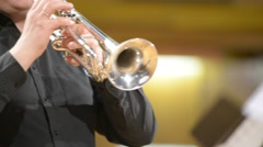 Trumpeter plays on a silver trumpet, blurred defocused background Stock Footage