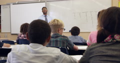 Kids watch teacher in math class, back view, shot on R3D Stock Footage
