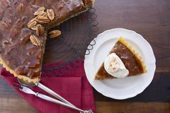 Pecan pie on dark wood background. Stock Photos