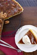 Pecan pie on dark wood background. - stock photo