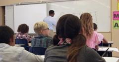 Teacher taking 5th grade maths class, back view, shot on R3D Stock Footage