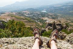 Men in sport sandals lies on the top of Demerdzhi mountain. Close up detail o - stock photo