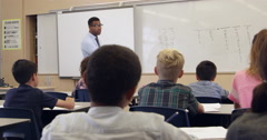 Teacher asks question in math class, back view, shot on R3D Stock Footage