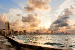 Famous embankment promenade Malecon at sunset. Havana, Cuba. Stock Photos