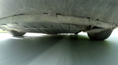 Driving a car on a country road. Wheels spinning POV - Point of View, day cou Stock Footage