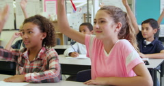 School kids answering questions in class, shot on R3D Stock Footage