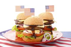 The Great BBQ Hamburger with Flags Stock Photos