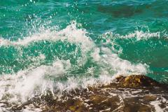 Photo of beautiful clear turquoise sea ocean water surface with ripples and - stock photo