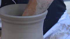 Process Expansion of Pottery With Help of Hands and a Potter's Wheel - stock footage