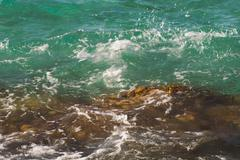 Photo of beautiful clear turquoise sea ocean water surface with ripples and Stock Photos