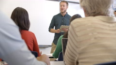 Male teacher taking an adult education class, shot on R3D - stock footage