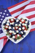 Red, white and blue berries with fresh whipped cream stars Stock Photos