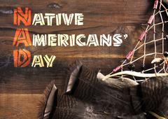 Native Americans Day wood carving style greeting - stock photo