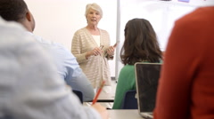 Senior woman with tablet teaching adult education class - stock footage