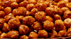 Caramelized hazelnuts at the La Boqueria food market, Barcelona, Spain Stock Footage