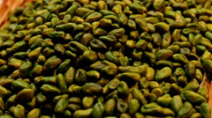 Dolly of raw pistachios at the La Boqueria food market, Barcelona, Spain - stock footage