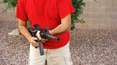 Man with AR-15 Quickly Loads a New Magazine Stock Footage