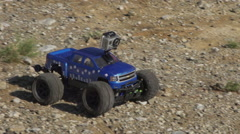 RC truck driving over gravel in slow motion - stock footage