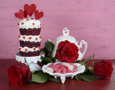 Novelty triple layer red velvet cupcake - stock photo