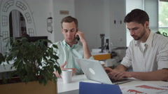 Team of young businessmen working at the office in the morning Stock Footage