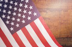 USA Stars and Stripes Flag on Dark Wood - stock photo