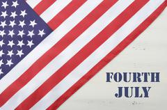 Happy Fourth of July USA Flag on White Wood Table - stock photo