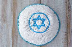 Flat lay of a Knitted kippah with embroidered blue and white Star of David Stock Photos