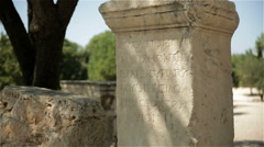 Scriptures on a rock in the Ancient Agora of Athens, Greece Stock Footage