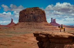 Horseback Riding John Ford's Point - Monument Valley - stock photo