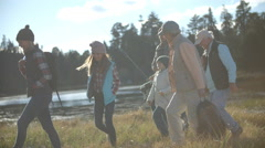 Multi generation family arriving at tent in countryside Stock Footage