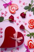 Valentine roses, lollipops and gift Stock Photos
