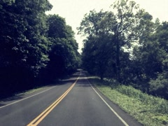 8mm Vintage Style Car Driving on Country Road Stock VIdeo Stock Footage