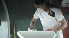 Surfboard making, forming the black Stock Footage