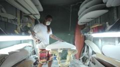 Surfboard shaping, Shaper hand sanding surfboard Stock Footage