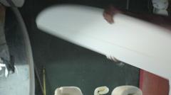 Surfboard shaping, shaper flipping the blank surfboard Stock Footage
