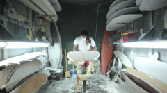 Surfboard shaping, Shaper using a foam sander to shape the nose of the surfboard Stock Footage