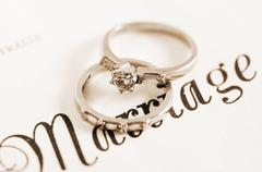 Wedding rings on marriage certificate. Stock Photos