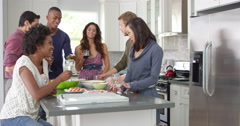 Friends socialising in a kitchen, full length, shot on R3D Stock Footage