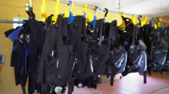 4K Scuba Wetsuits Hanging At The Dive Shop Rack Focus Arkistovideo