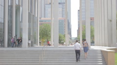 Couple walk under Long arches of minneapolis - stock footage