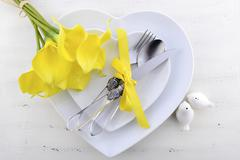 Yellow and white theme wedding table place setting. Stock Photos