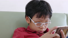 boy playing games on phone - stock footage