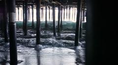 Waves Crashing Under California Pier Stock Footage