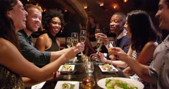Group Of Friends Enjoying Meal In Restaurant Shot On R3D Stock Footage