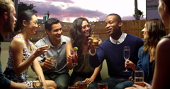 Friends Enjoying Night Out At Rooftop Bar Shot On R3D Stock Footage