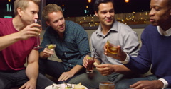 Male Friends Enjoying Night Out At Cocktail Bar Shot On R3D Stock Footage
