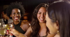 Female Friends Enjoy Night Out At Cocktail Bar Shot On R3D Stock Footage
