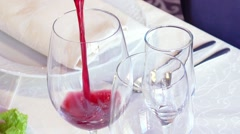 A man pours a glass of red wine Stock Footage