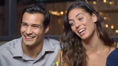 Group Of Friends Enjoy Night Out At Rooftop Bar, Slow Motion Stock Footage